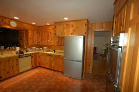 granite countertop white kitchen cabinets with wood floors