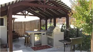 living designs backyards compact backyard hill plantings pavers patio 20