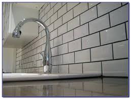 light grey brick tiles grey grout white tile beveled white subway tile with dark grout