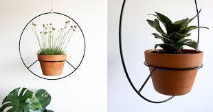 Modern Hanging Planters   these hanging planters are designed to put a distinct focus on your