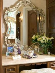 home decor make up table and floral arrangement with wood framed