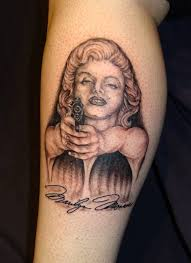 marilyn monroe and gun tattoo on leg