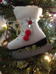 ice skate ornament made out of felt pom poms cotton batting and