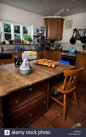 traditional country kitchen with cup cakes cooling on the table uk