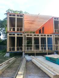 second quadruple shipping container duplex getting wrapped up on