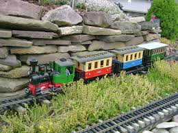 add the element of motion to your garden with a model railway