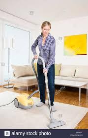 woman vacuuming stock photo royalty free image 149271776 alamy