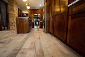 what color wood floor looks with cherry cabinets wood look tile and cherry cabinets hardwood floors in