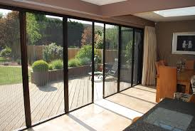 large patio door with fly screens letting fresh air in and keeping