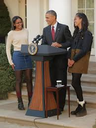 pictures of and malia obama in their thanksgiving 2015