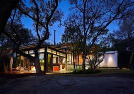 modern box house from outdoor the interior view at night modern house living design