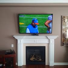 tv installed above fireplace bell fibe wireless tv setup with