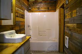 wood bathroom ideas covering walls with pallet wood the basement bathroom renovation