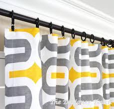 two yellow grey curtain panels geometric window treatments