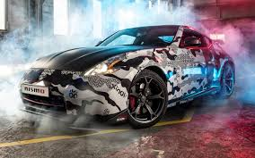 nissan 370z nismo wallpaper wallpapers nissan 370z nismo gumball 3000 cars smoke 1920x1200