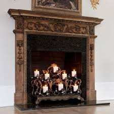 ornate fireplace with fireplace candelabra creating beautiful