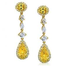 karigari earrings gold toned canary colored cz teardrop earrings