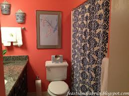 coral bathroom with blue patterned shower curtain feasts and