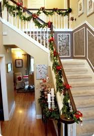 Banister Christmas Ideas Christmas Stairs I Like Wrapping With Greens Instead Of Draping