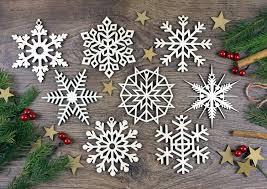 set of 8x wooden snowflake ornaments laser cut