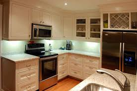 particle board kitchen cabinets kitchen countertops faucet sink refrigerator tea maker burlywood