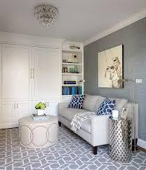 light gray linen sofa with blue trellis pillows transitional