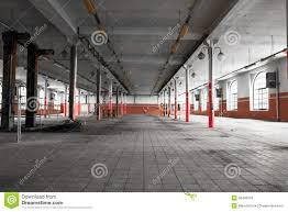 an old empty industrial warehouse interior royalty free stock