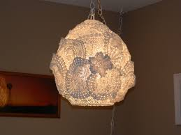 doily swag lamp and notebook covers on my creative side
