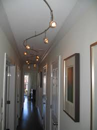 Entry Foyer Lighting Ideas interior hallway light with rustic black iron cage and arm also