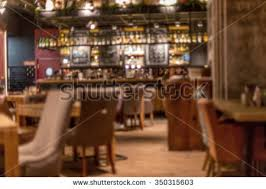 classic bar counter bottles blurred background stock photo