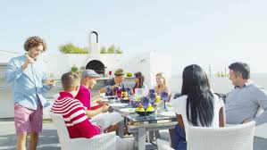 happy diverse of family and friends enjoying a meal outdoors