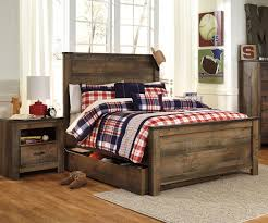 buy our ashley trinell b446 full size panel bed with trundle at