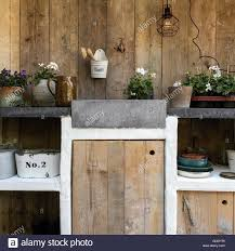 outdoors kitchen used for gardening and growing plants stock photo