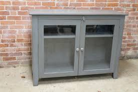 Glass Tv Cabinets With Doors by Furniture Grey Wooden Tv Cabinet With Swing Glass Door And Two