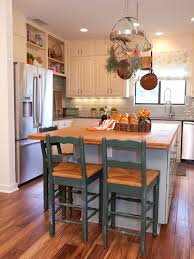 custom kitchen islands pictures ideas tips from hgtv country cream kitchen with island and pot rack