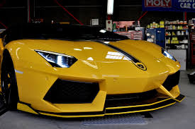 yellow lamborghini front bright yellow lamborghini aventador by bond cars osaka front