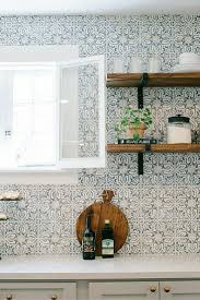 gorgeous patterned tile backsplash with bracketed wood open