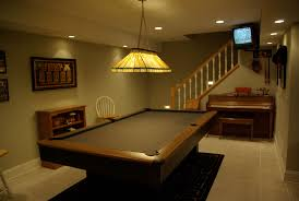 interior comfortable basement game room design with big billiard