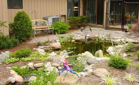 amazing backyard waterfall fish pond with paver patio