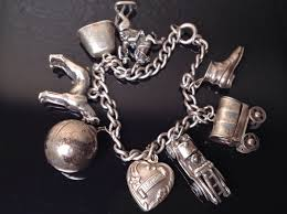 antique charm bracelet charms images Antique sterling charm bracelet 8 charms puffy heart moving parts JPG