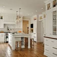 kitchen center islands with seating a gray gray kitchen cabinets downpipe and skimming