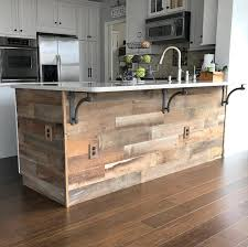 reclaimed kitchen island the reclaimed brown on this kitchen island remodel is amazing