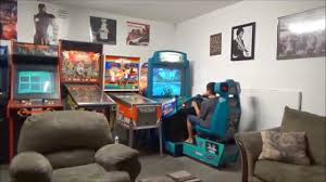 arcade game room and garage provided in our cabin rental youtube