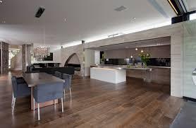 open kitchen island beautiful chandelier wooden floor fancy dining set stainless steel