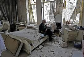 White Bedroom Records Photo Of A Syrian Man Listening To Records In His Bombed Out