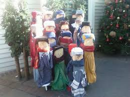 fence post carolers uses knitted hats and old sweaters crafts