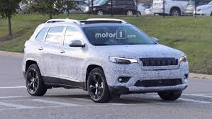2018 jeep 2018 jeep cherokee spied showing its redesigned headlights