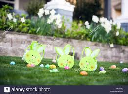 bunny baskets three green easter bunny baskets on the grass with easter eggs and