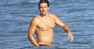 Nude Beach Meme - orlando bloom pictured completely naked while paddle boarding with
