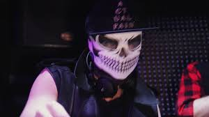 dj man in skeleton mask black cap and vest playing music on mixing